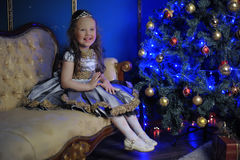 Little girl decorates   Christmas tree Royalty Free Stock Photos