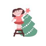 Little girl decorates Christmas tree Stock Photo