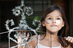 Little girl decorates the gate of the house. The Little girl decorates the gate of the house royalty free stock photo