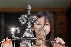 Little girl decorates the gate of the house royalty free stock images