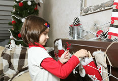 Little Girl Decorating for Christmas Royalty Free Stock Photos