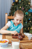 Little girl decorating of christmas gingerbread cookie Stock Image