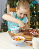 Little girl decorating of christmas gingerbread cookie Royalty Free Stock Photography