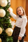 Little girl decorating christmas tree. Royalty Free Stock Image