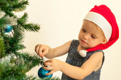 Little girl decorating the christmas tree Stock Photo