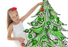 Little girl decorating Christmas tree Stock Photo