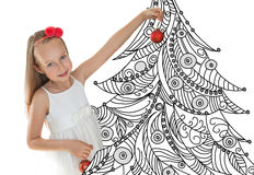 Little girl decorating Christmas tree Stock Images