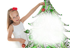 Little girl decorating Christmas tree Royalty Free Stock Photography