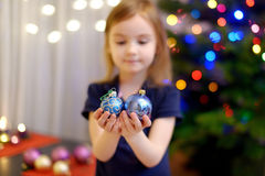 Little girl decorating a Christmas tree Royalty Free Stock Photo