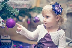 Little girl decorating the Christmas tree Royalty Free Stock Photo