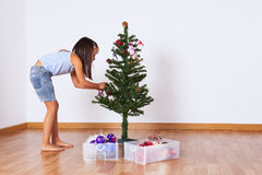 Little girl decorating a christmas tree Stock Image
