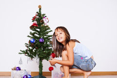 Little girl decorating a christmas tree Royalty Free Stock Photography
