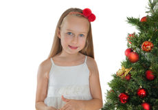 Little girl decorating Christmas tree Royalty Free Stock Photo