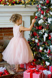 Little girl decorating Christmas tree at home Stock Photography