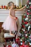 Little girl decorating Christmas tree at home Royalty Free Stock Photography