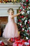 Little girl decorating Christmas tree at home Stock Photo