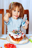 Little girl decorating easter cake Stock Image