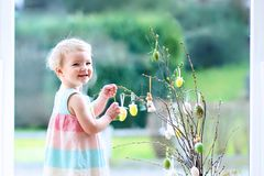 Little girl decorating home for Easter Royalty Free Stock Image