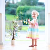 Little girl decorating home for Easter Stock Photos