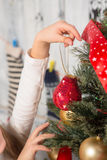 Little girl decorating New Year tree at home Royalty Free Stock Photos