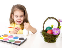 Little girl decorating traditional Easter egg Royalty Free Stock Photography