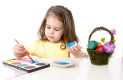 Little girl decorating traditional Easter egg Stock Images