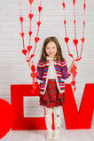Little girl with decoration for Valentines Day Royalty Free Stock Photo