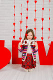 Little girl with decoration for Valentines Day Stock Photography