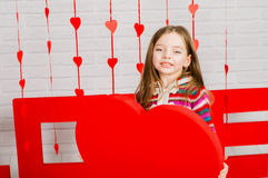 Little girl with decoration for Valentines Day Stock Images