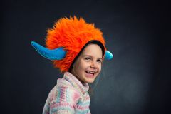 Little girl in decorative helmet Stock Images