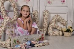 Little girl in a decorative suitcase Royalty Free Stock Image