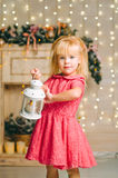 Little girl with decorative vintage lamp Stock Images