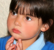 Little Girl Deep In Thought. Face of a little girl deep in thought Royalty Free Stock Image