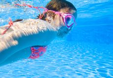 Girl swim in  pool. Little girl deftly swim underwater in pool Royalty Free Stock Images
