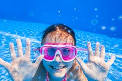 Girl swim in  pool. Little girl deftly swim underwater in pool Royalty Free Stock Photography