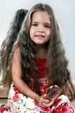 Little girl with delicious hair Stock Image