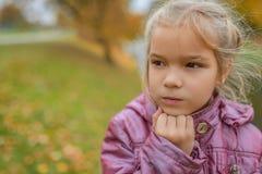 Little girl in demi-season coat Royalty Free Stock Photos