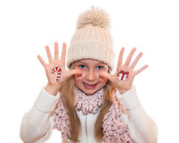 Little girl demonstrating Christmas present box painted on kid's hand Royalty Free Stock Images