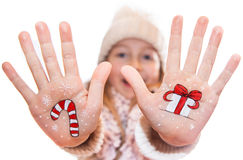 Little girl demonstrating Christmas present box painted on kid's hand Royalty Free Stock Photo