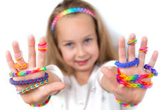 Little girl demonstrating her works from loom bangs Royalty Free Stock Image