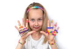 Little girl demonstrating her works from loom bangs Stock Photo