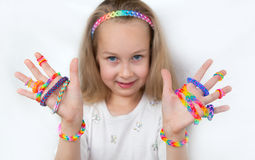 Little girl demonstrating her works from loom bangs Royalty Free Stock Photography