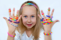 Little girl demonstrating her works from loom bangs Stock Images