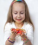 Little girl demonstrating her works from loom bangs Royalty Free Stock Photos