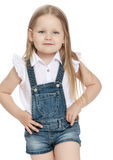 Little girl in denim shorts royalty free stock image