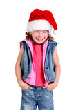 Little girl in denim suit and a hat of Santa Claus Royalty Free Stock Photography