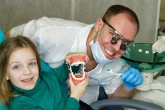 Little girl in dental clinic stock photo