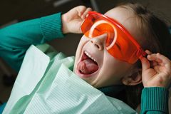 Little girl in dental clinic stock image