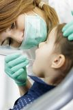 Little girl at the dentist Royalty Free Stock Image