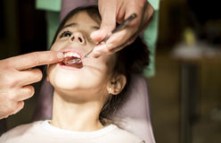 Little girl at the dentist checkup Stock Images